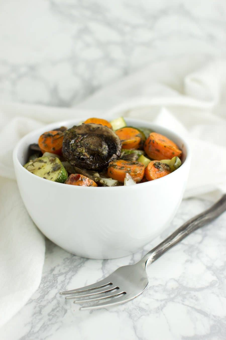 Roasted Mixed Vegetables with Charmoula Sauce recipe from acleanplate.com #aip #paleo #autoimmuneprotocol