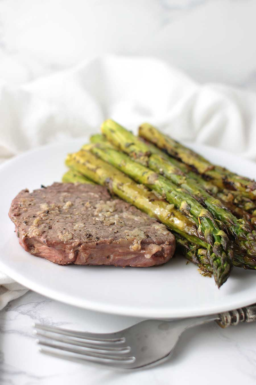 AIP Garlic Steak with Lemon-Pepper Asparagus recipe from acleanplate.com