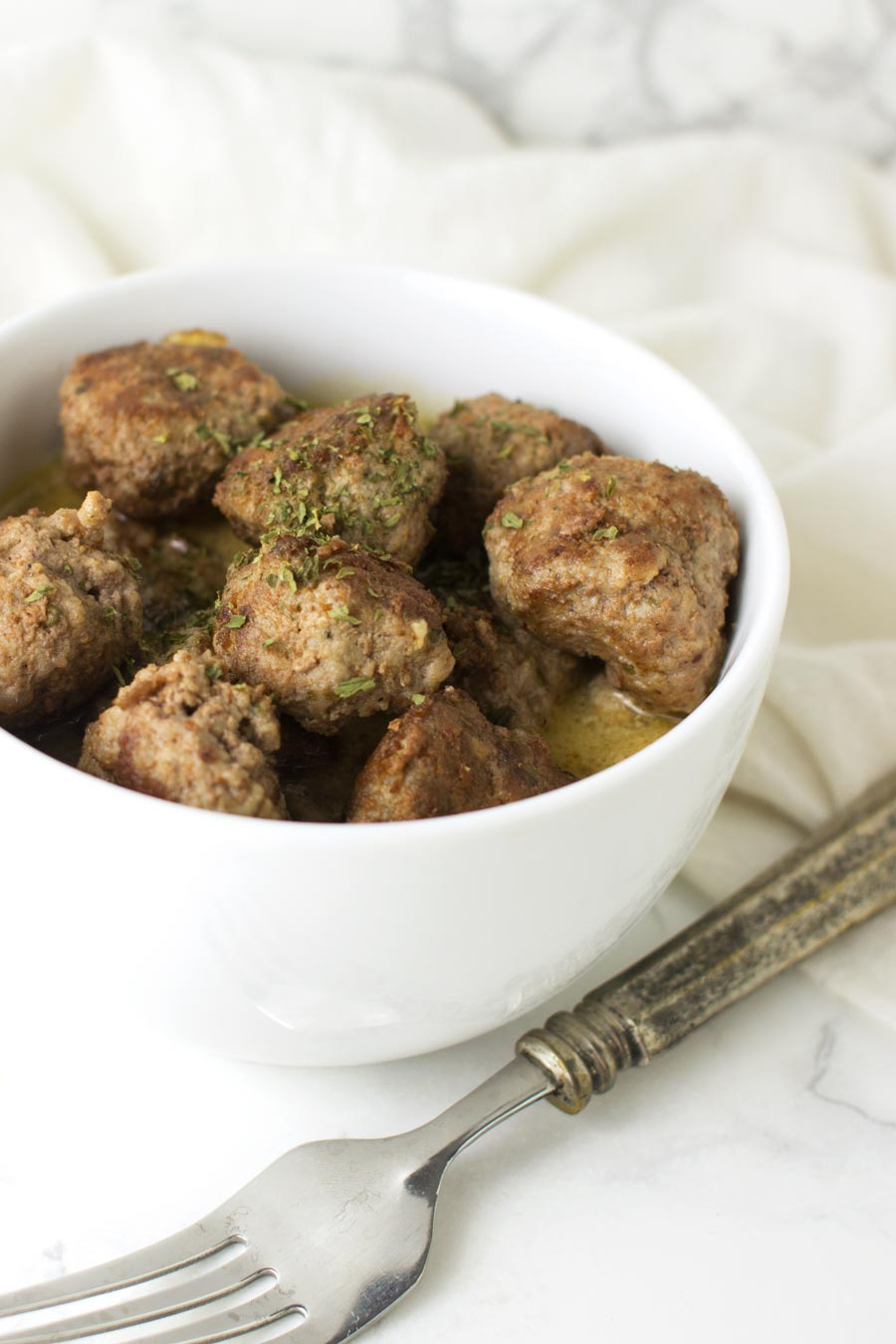 Lamb Meatballs with Mushroom Sauce recipe from acleanplate.com #paleo #aip #glutenfree