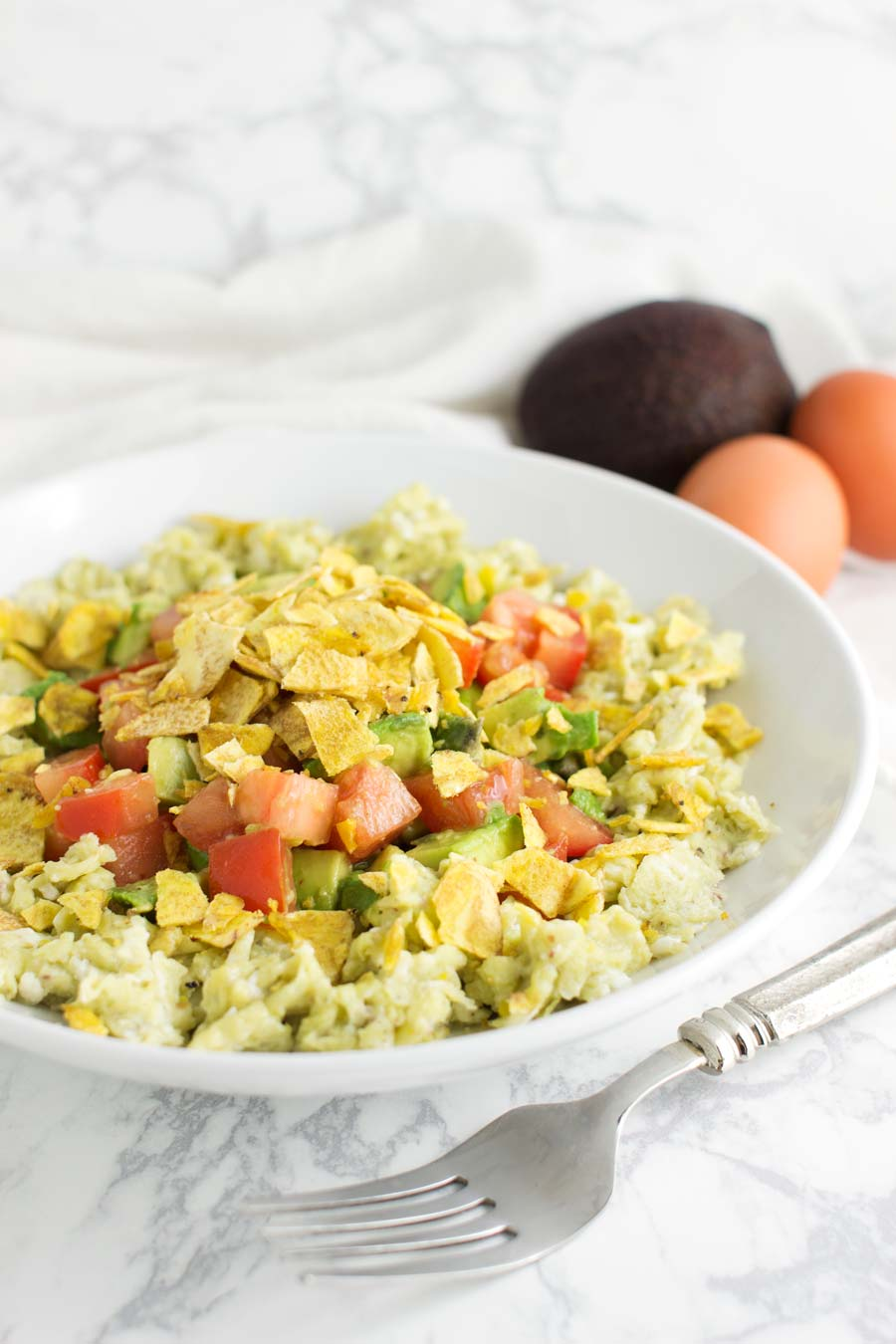 Tex-Mex Scrambled Eggs Migas recipe from acleanplate.com #paleo #glutenfree #dairyfree
