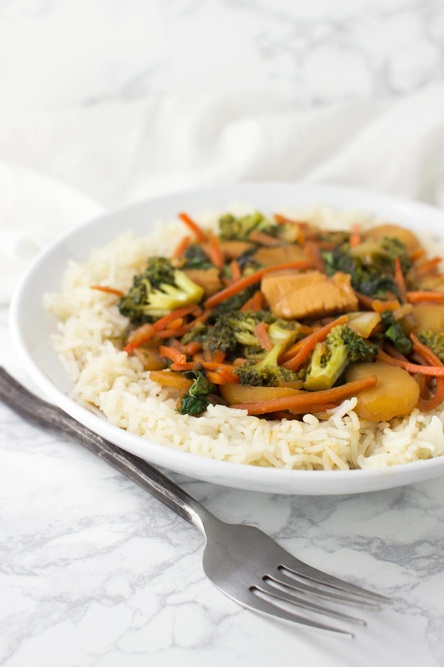 Chicken Stir-Fry with Cauliflower Rice recipe from acleanplate.com #paleo #aip #glutenfree