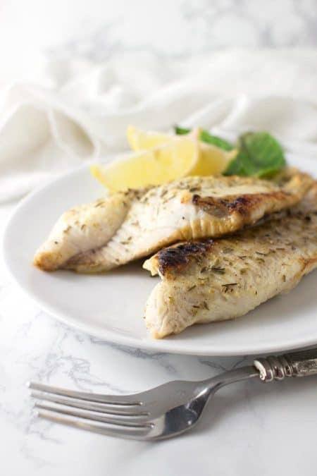 Garlic and Herb Catfish recipe from acleanplate.com #aip #paleo #autoimmuneprotocol