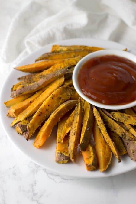 Garlic Herb Sweet Potato Fries recipe from acleanplate.com #aip #paleo #autoimmuneprotocol