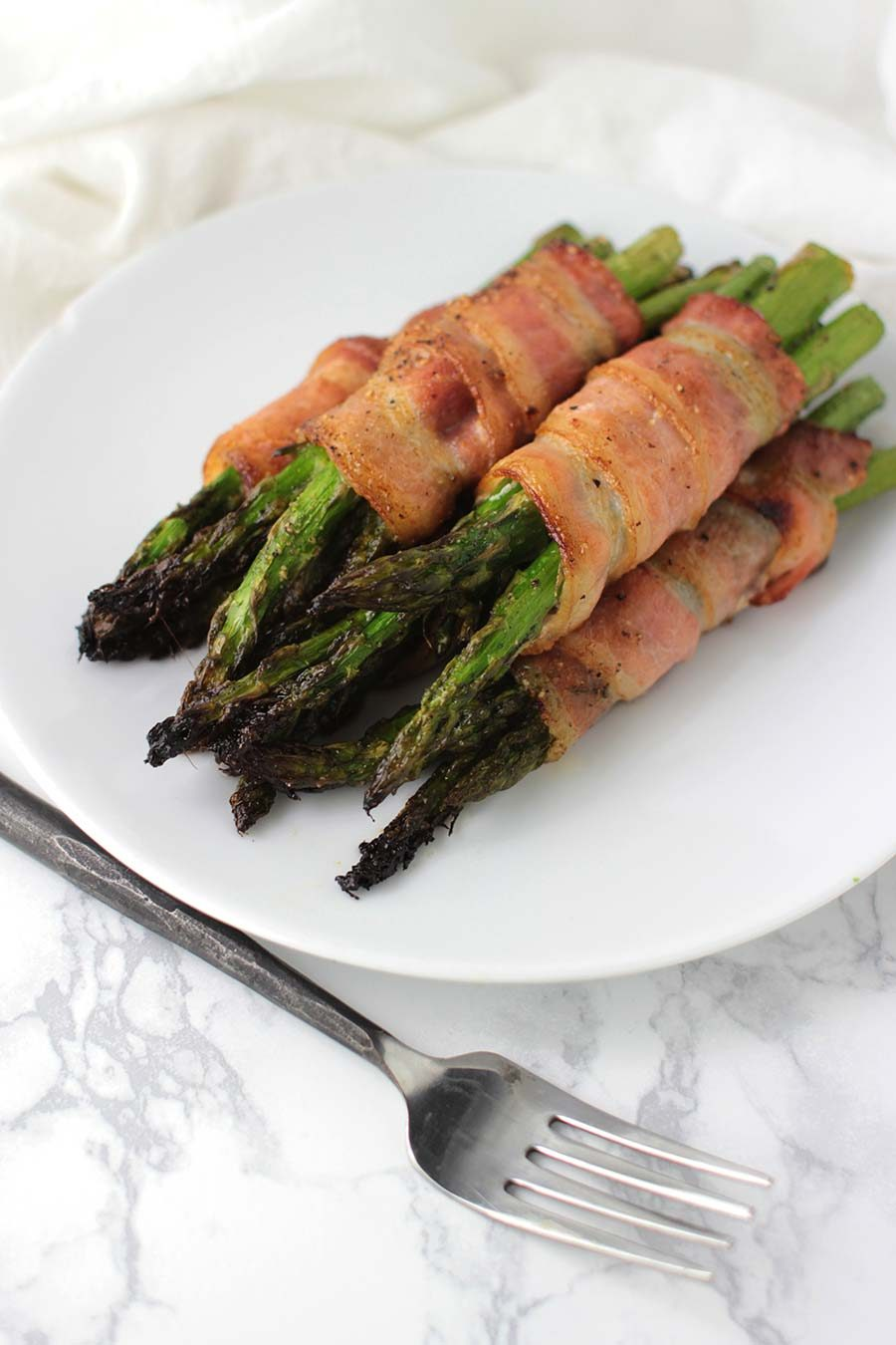 Bacon-Wrapped Asian Asparagus recipe from acleanplate.com #aip #autoimmuneprotocol #paleo