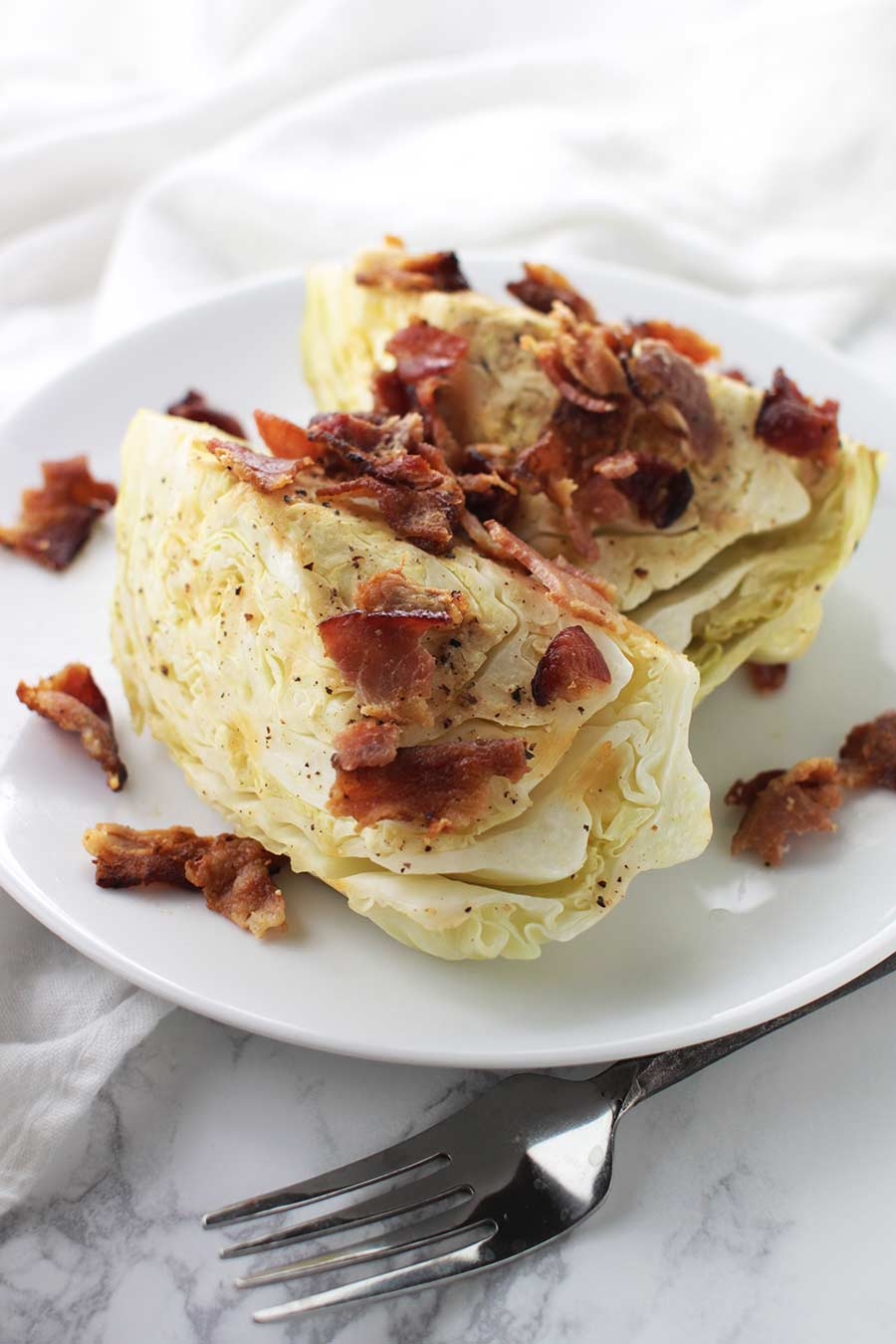 Garlic-Bacon Cabbage recipe from acleanplate.com #aip #autoimmuneprotocol #paleo